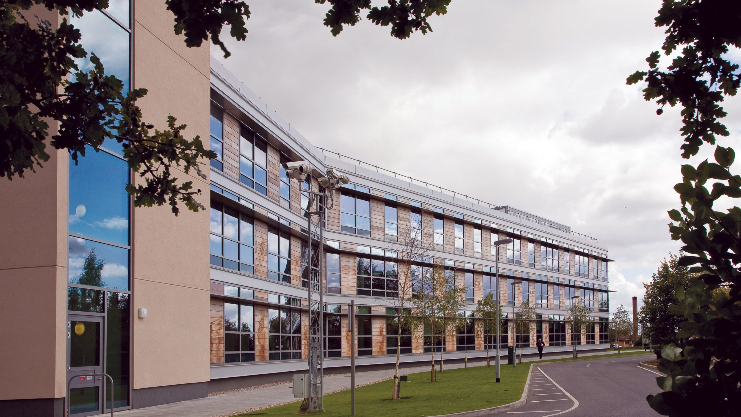Exterior of one of our buildings at Hanslope Park. Modern offices with large glass windows.
